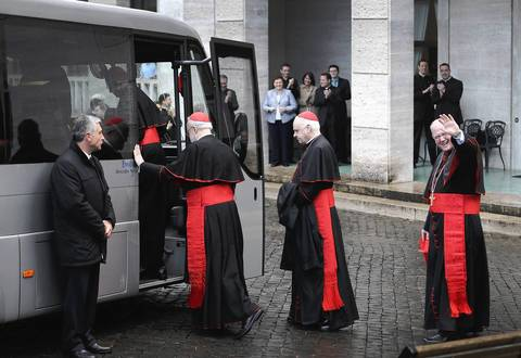 American Cardinals (L-R) Sean P. O'Malley, Keith O'Brien and Timothy M. Dolan board a bus to take them from the North American College to St. Peter's Basilica where a Pro Eligendo Romano Pontifice Mass will be celebrated before they enter the Conclave to decide who will be the next Pope. Cardinals are set to enter the conclave to elect a successor to Pope Benedict XVI after he became the first pope in 600 years to resign from the role.