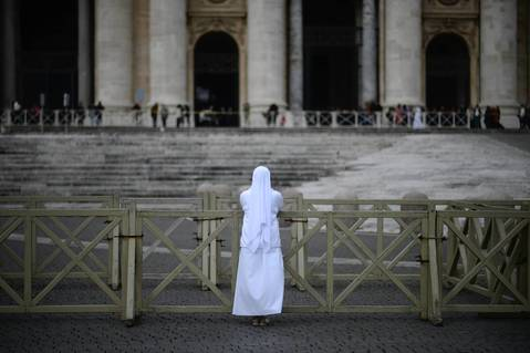 A nun prays in front of the St. Peter's Basilica early at the Vatican. Cardinals moved into the Vatican today as the suspense mounted ahead of a secret papal election with no clear frontrunner to steer the Catholic world through troubled waters after Benedict XVI's historic resignation. The 115 cardinal electors who pick the next leader of 1.2 billion Catholics in a conclave in the Sistine Chapel will live inside the Vatican walls completely cut off from the outside world until they have made their choice.