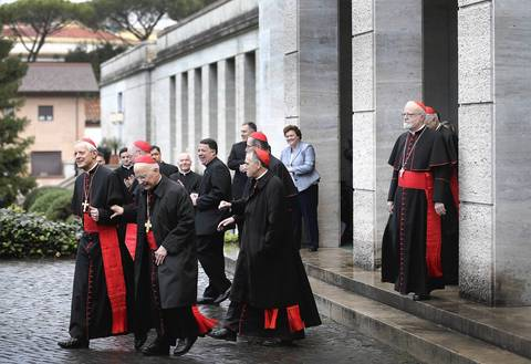 American Cardinals walk to a bus to take them from the North American College to St. Peter's Basilica where a Pro Eligendo Romano Pontifice Mass will be celebrated before they enter the Conclave to decide who will be the next pope.