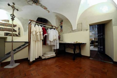 """Vestments of the next Pope, hanging in the """"Room of Tears,"""" a small room next to the Sistine Chapel, right, are displayed in three different sizes, before the start of the conclave at the Vatican. Cardinals moved into the Vatican today as the suspense mounted ahead of a secret papal election with no clear frontrunner to steer the Catholic world through troubled waters after Benedict XVI's historic resignation."""
