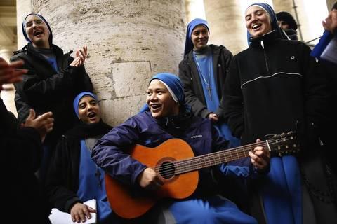 Nuns from the 'Instituto Serve del Signore, E Della Vergine Di Matara' sing hymns under the colonnade in St. Peter's Square in Vatican City, Vatican.