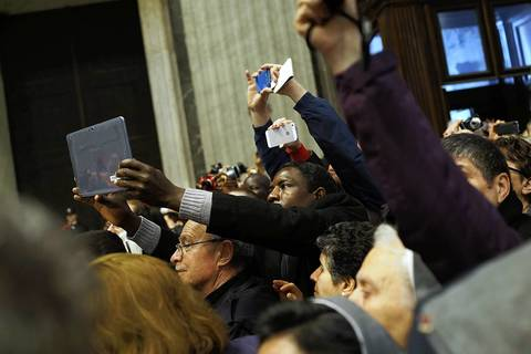 People try to get a picture of the Cardinals while attending the Pro Eligendo Romano Pontifice Mass at St. Peter's Basilica, after which Cardinals will enter the conclave to decide who will be the next pope.
