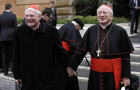 Cardinals Angelo Scola, left, and Ennio Antonelli, both of Italy, arrive for a meeting at the Synod Hall.