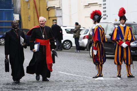 Archbishop of Kinshasa Laurent Monsengwo Pasinya, left and Canadian Cardinal Marc Ouellet leave the Paul VI Hall at the end of a session.