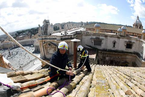 Vatican firefighters set up one of the chimneys roof of the Sistine chapel.