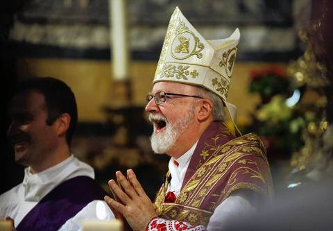 Boston Cardinal Sean O'Malley laughs during an address by a priest while leading mass at the Santa Maria Della Vittoria church in Rome. Roman Catholic Cardinals prayed on Sunday for spiritual guidance ahead of a closed door conclave to choose a new pope to lead the Church at one of the most difficult periods in its history.