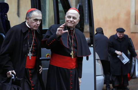 Cardinal Daniel Di Nardo, left, and Cardinal Francis George, right, from U.S., arrive for a meeting at the Synod Hall in the Vatican. Catholic cardinals said on Tuesday they wanted time to get to know each before choosing the next pope and meanwhile would seek more information on a secret report on alleged corruption in the Vatican.