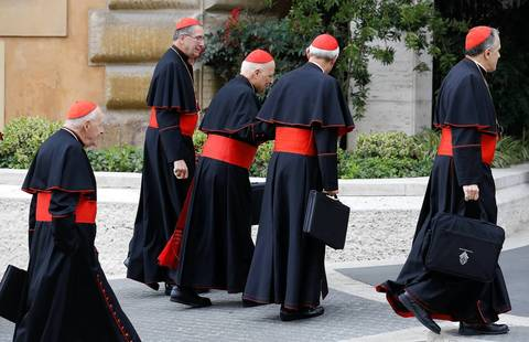 U.S. Cardinals Theodore McCarrick, from left, Roger Mahony, Francis George, Donald Wuerl and Daniel DiNardo arrive for a meeting at the Synod Hall in the Vatican on Tuesday.