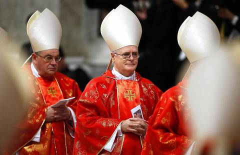 Cardinal Odilo Scherer of Brazil, center, leaves after a mass in St. Peter's Basilica at the Vatican. All cardinals, including those over 80 who will not vote in the conclave, celebrated mass in St. Peter's Basilica to pray for the election of the new pope.