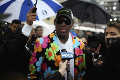 Basketball star Dennis Rodman walks near to the Vatican as he shows support for a black papal candidate in Vatican City, Vatican.