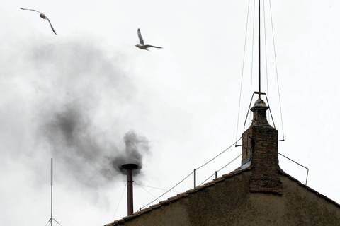 Black smoke rises from the chimney on the roof of the Sistine Chapel meaning that cardinals failed to elect a new pope in the second ballot of their secret conclave at the Vatican.