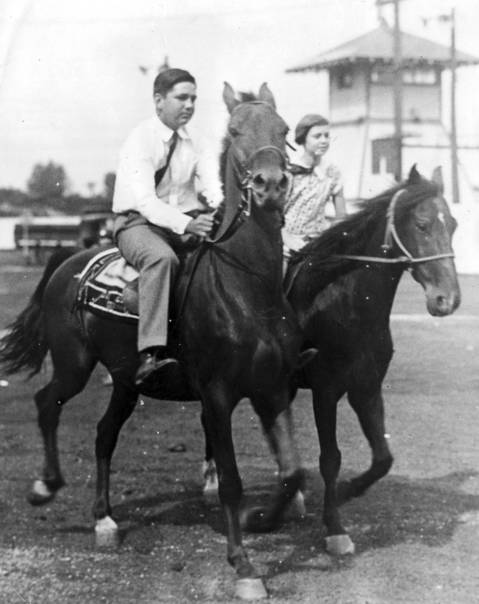 """Eddie spent much of his time in Chicago, where riding was his favorite sport, next to swimming,"" said his sister Patricia, seen here with him riding horses. Undated photo ran in the newspaper on Oct. 2, 1949."