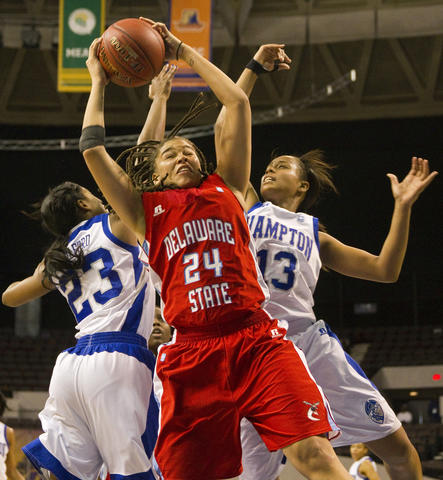(From left) JoNiquia Guilford, Tierra Hawkins and Keiara Avant battle for a rebound during the first half of Wednesday's MEAC Tournament quarterfinal game between Hampton and Delaware State.