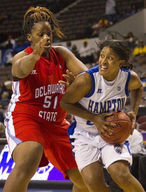 Hampton's JoNiquia Guilford drives past Delaware State's Uchechi Ahaiwe during the second half of Wednesday's MEAC Tournament quarterfinal game at Norfolk Scope Arena.
