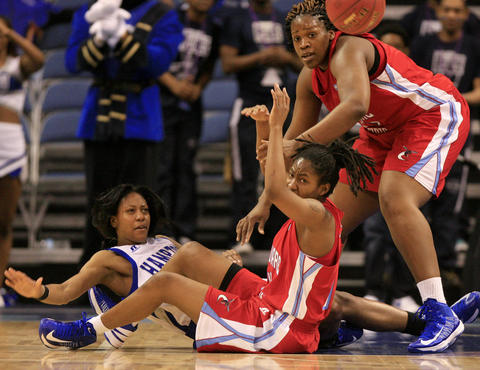 (From left) Ariel Phelps, Keyanna Tate and Uchechi Ahaiwe fight for possession during the first half of Wednesday's MEAC Tournament quarterfinal game between Hampton and Delaware State.