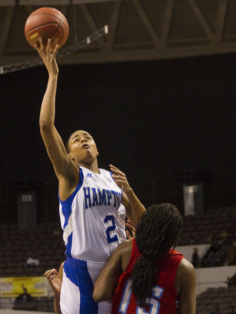 Hampton's Nicole Hamilton lays up a shot over Delaware State's Kianna D'Oliverira during the first half of Wednesday's MEAC Tournament quarterfinal game.