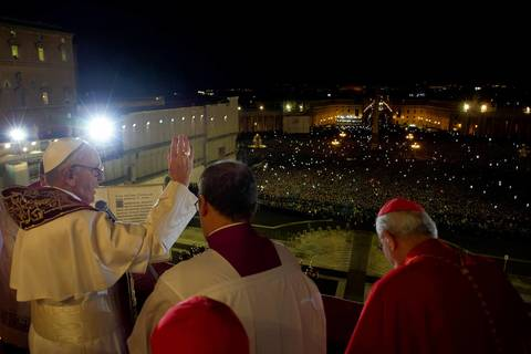 Argentina's Jorge Bergoglio (L), elected Pope Francis, appearing at the window of St Peter's Basilica's balcony after being elected the 266th pope of the Roman Catholic Church