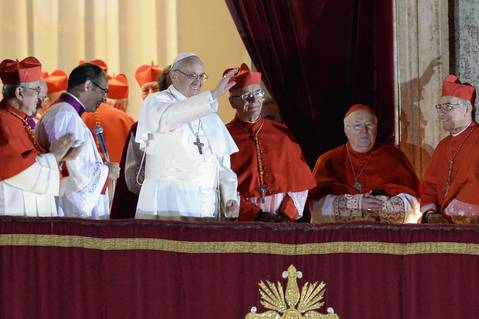 Cardinal Jorge Bergoglio, elected Pope Francis, appears with cardinals at the window of St Peter's Basilica after being elected.