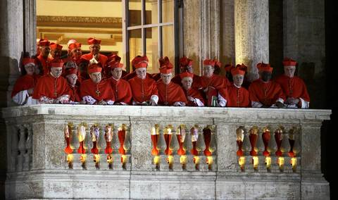 Cardinals watch newly elected Pope Francis, Cardinal Jorge Mario Bergoglio of Argentina, as he appears at St. Peter's Basilica after being elected by the conclave of cardinals.