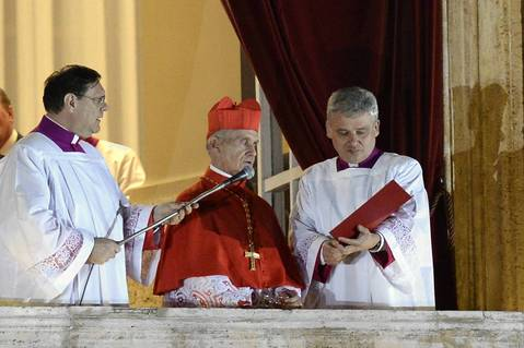 French proto-deacon cardinal Jean-Louis Tauran (C) announces the name of the new Pope, Argentinian cardinal Jorge Mario Bergoglio from the balcony of St Peter's basilica at the Vatican.