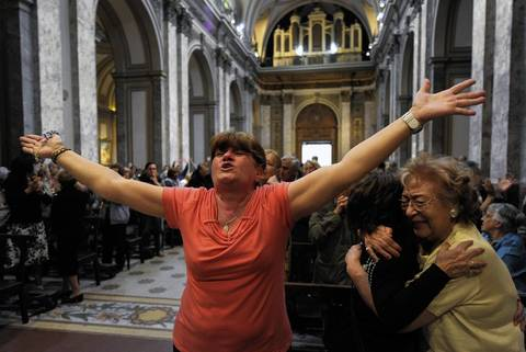 Faithful at Metropolitan Cathedral in Buenos Aires react after the announcement that Buenos Aires archbishop Jorge Mario Bergoglio was elected Pope Francis. Bergoglio becomes the church's first Latin American pontiff after a conclave to elect a leader of the world's 1.2 billion Catholics. He is the first Jesuit to become pope and is believed to have been the runner-up in 2005.