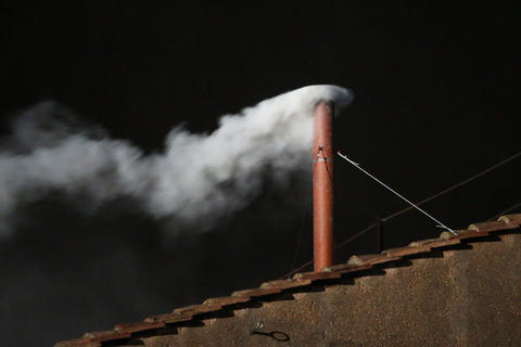 White smoke is seen from the roof of the Sistine Chapel indicating that the College of Cardinals have elected a new pope.