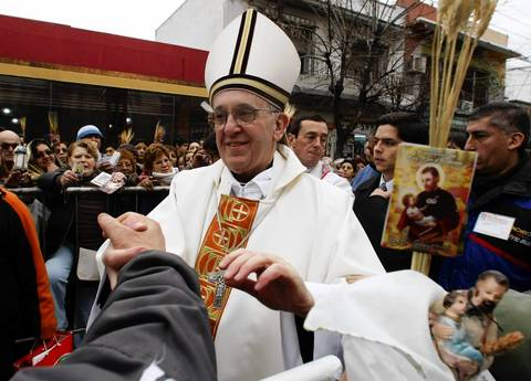 Archbishop of Buenos Aires Cardinal Jorge Mario Bergoglio greets worshippers, in the Buenos Aires neighborhood of Liniers.
