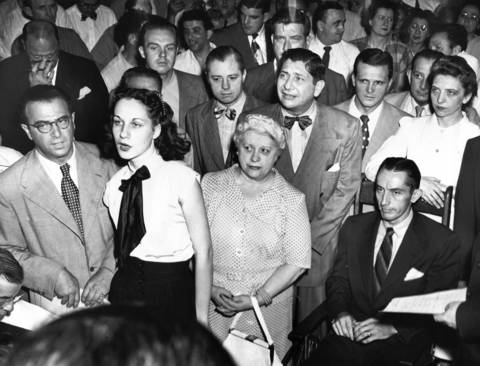 Ruth Steinhagen, second from left, faces the bench at Chicago Felony Court on her arraignment on charges of assault with intent to kill baseball star Eddie Waitkus who is sitting in the wheelchair at the right. Within a day, the 19-year-old woman was indicted by a grand jury, found insane by a jury, and committed to Kankakee State Hospital.