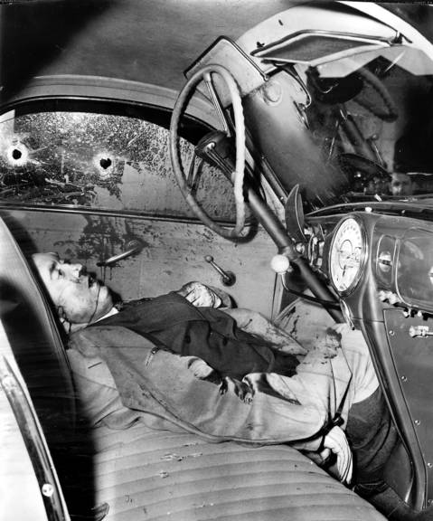 Edward J. O'Hare was shot to death in his car on Nov. 8, 1939. O'Hare died of two shotgun blasts as he raced his automobile northeast on Ogden Avenue near Rockwell Street in Chicago in a futile effort to outdistance the men who would kill him. The death car drew alongside, its occupants fired into O'Hare's head and neck, and the the assassin's car sped away. Reports were that the death was connected with Al Capone's imminent release from prison.