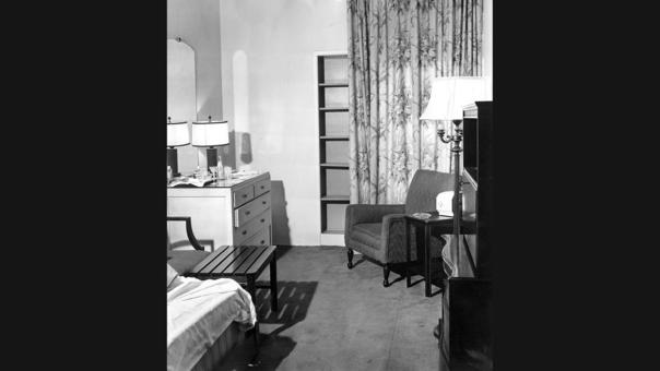 Room 1297A at the Edgewater Beach Hotel where baseball player Eddie Waitkus was shot. At right is the chair where Waitkus sat when Ruth Steinhagen fired her rifle. At left is a dresser with a martini glass and drink mixes.