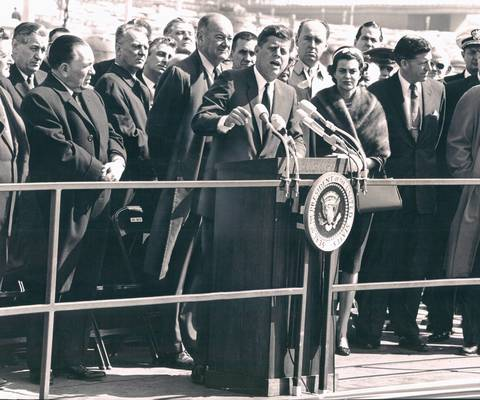 "President John F. Kennedy speaks at a dedication ceremony at O'Hare International Airport on March 23, 1963. ""Among airports, it is first in nation, like so many other things about Chicago,"" he said. Mayor Richard J. Daley is on the left."