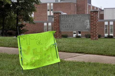 "A hand made sign saying ""Pray 4 Daniel!"" is staked outside Perry Hall High School."