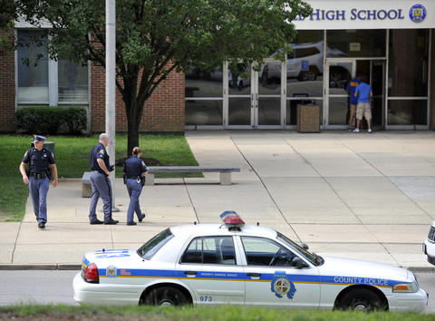 Baltimore County police outside Perry Hall High School Tuesday morning, a day after a shooting in the school cafeteria.