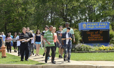 Students are evacuated from Perry Hall High School after one student shot another student on the first day of school.