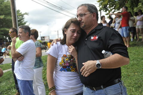 Juliana DiPaula hugs her dad John DiPaula after they are reunited following the shooting at Perry Hall High School.