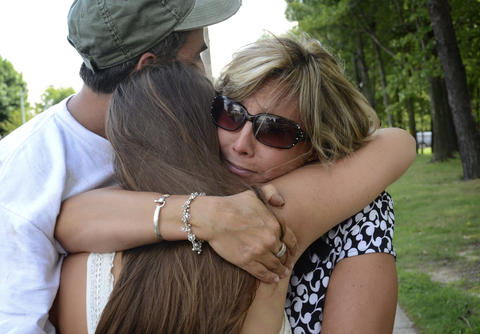 Dawn and Carmen Scarpulla have an emotional reunion with their daughter, Brianna, 15, a junior, who saw a student with the gun. A student was shot on the first day of school at Perry Hall High School.