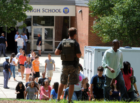 Students are evacuated after a student was shot on the first day of school at Perry Hall High School.
