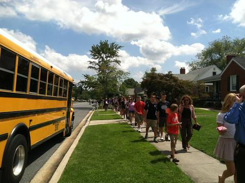 Perry Hall High School students walk up Ebenezer Road following the shooting.