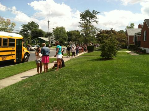 Another image of students walking up Ebenezer Road after the shooting at Perry Hall High School Monday morning.