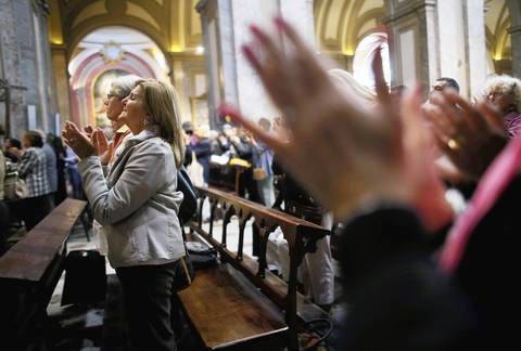 People applaud in the Metropolitan Cathedral in Buenos Aires, Argentina, at the conclusion of Mass on the day after Pope Francis, formerly Cardinal Jorge Mario Bergoglio, was elected at the conclave. Francis was the Archbishop of Buenos Aires and is the first Pope to hail from South America.