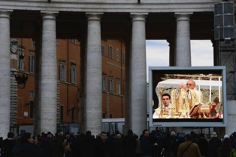 Members of the public watch Pope Francis celebrate Mass with the cardinals in the Sistine Chapel on a screen in St Peter's Square in Vatican City. The day before, thousands gathered in St Peter's Square to watch the announcement of the first ever Latin American Pontiff. It has been announced that Pope Francis' inauguration Mass will be held on March 19, 2013 in Vatican City.