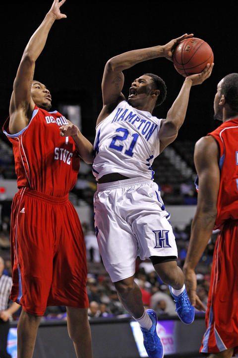 Hampton University's Ke'Ron Brown looks to the basket around Delaware State University's Kendall Gray, left, during Thursday's quarterfinals of the MEAC Tournament.