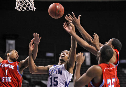 Hampton University's Wesley Dunning, center, battles for a rebound with Delaware State University's Kendall Gray, left, Marques Oliver, right, and Jordan Lawson, far right, during Thursday's quarterfinals of the MEAC Tournament.