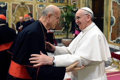 Newly elected Pope Francis, right, Cardinal Jorge Mario Bergoglio of Argentina, greets Vatican Secretary of State Tarcisio Bertone in the Clementine Hall at the Vatican. Pope Francis on Friday urged leaders of a Roman Catholic Church riven by scandal and crisis never to give in to discouragement, bitterness or pessimism but to keep focused on their mission.