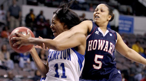 Ariel Phelps of Hampton grabs a rebound away from Cheyenne Curley-Payne of Howard during the first half of their MEAC tournamnet championship game Saturday in Norfolk.