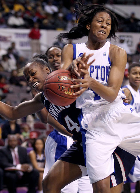 Ariel Phelps of Hampton University and Portia Deterville of Howard battle for the rebound during the first half of their MEAC tournamnet championship game Saturday in Norfolk.
