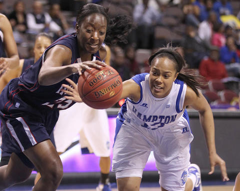 Keiara Avant of Hampton University and Julee O'Neal of Howard battle for a rebound during the the first half of their MEAC tournament championship game Saturday in Norfolk.