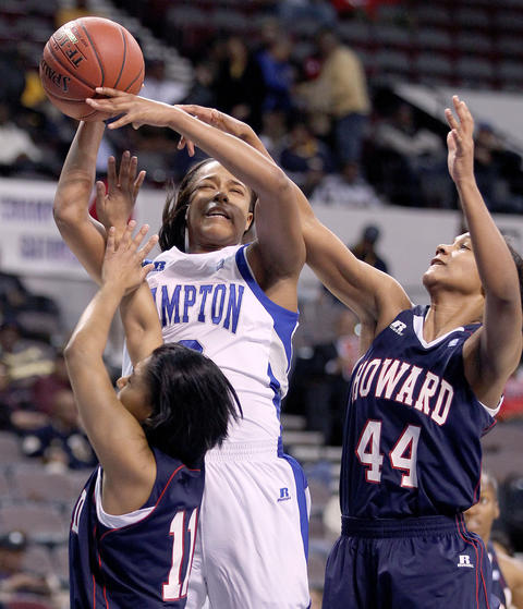 Keiara Avant of Hampton University is fouled by Kara Smith of Howard during the first half of their MEAC tournament championship game Saturday in Norfolk.