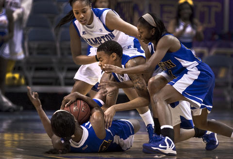 The Women's MEAC Tournament with HU vs Coppin State Friday held at Norfolk's Scope. Lose ball on the floor with CSU's#34 Larrisa Carter  and #14 Ashle Craig are trying to block out HU's #2 Nicole Hamilton and #13 Keiara Avant.