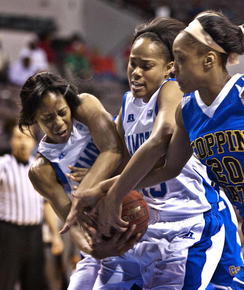 Women's MEAC Tournament HU vs Coppin State held Friday at Norfolk's Scope. HU's #11 Ariel Phelps,  HU's #13 Keiara Avant  and CSU #20 Kyra Coleman fight for the ball during a rebount.